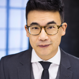 A headshot of Simon Tam